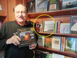 Thomas Cochrane with all 3 of the books he's authored at Four-Eyed Frog Books in Gualala, CA